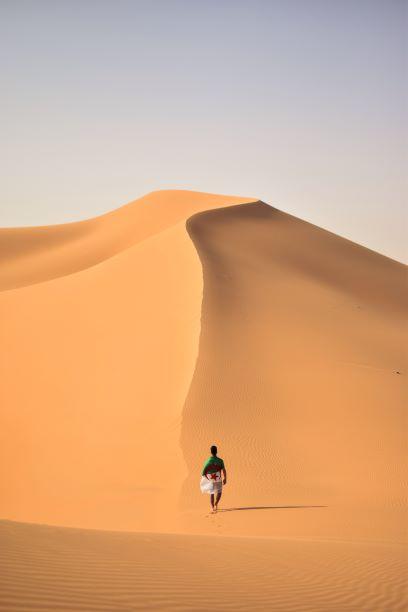 man-walking-on-desert-algeria